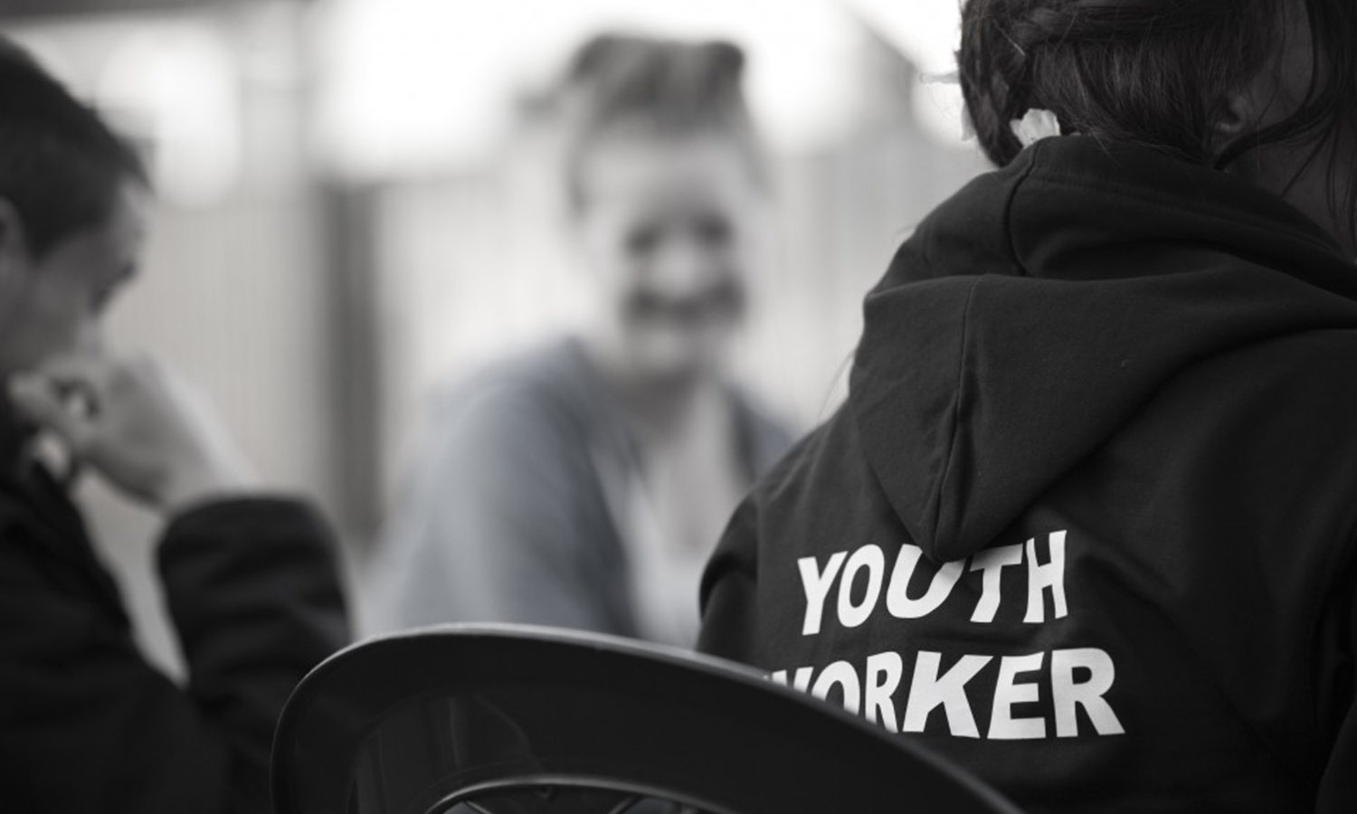 A picture of a youth worker working with young people