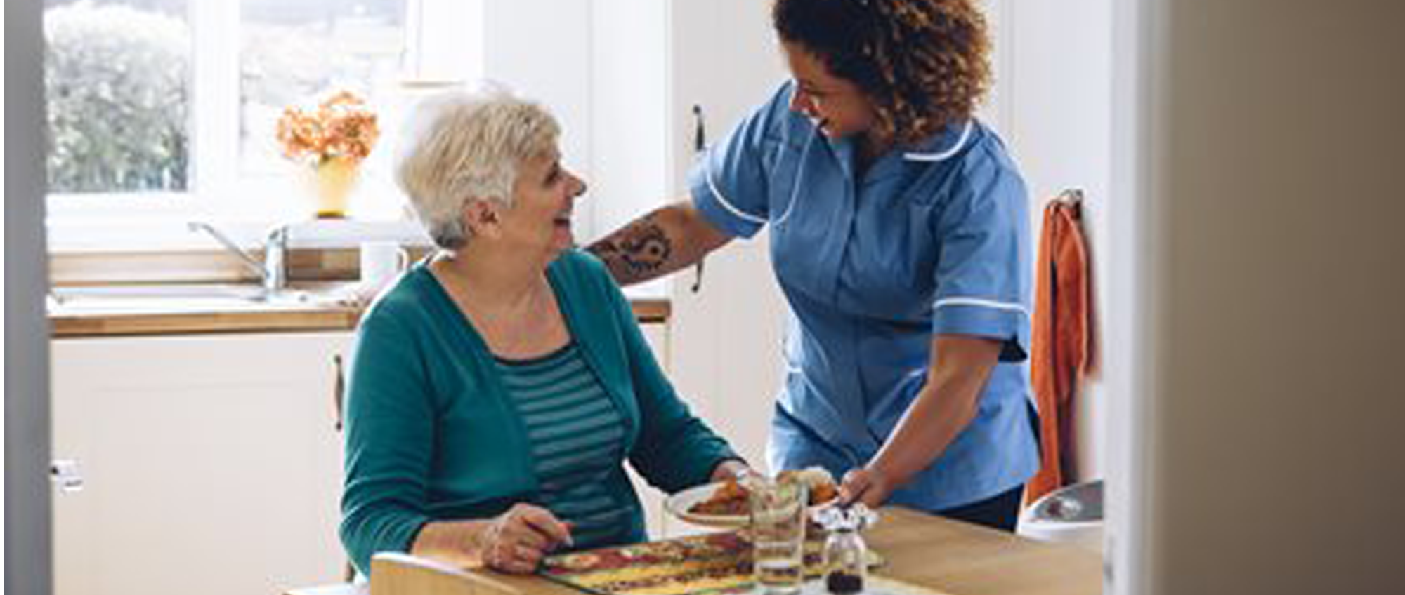 Care worker talking to a woman
