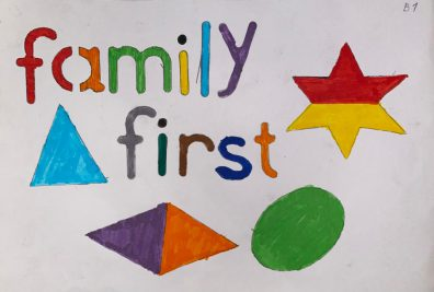 Photo of the words family first with stars and shapes