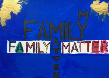 The words family matters hand painted